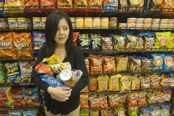 Author at a convenience store shows some of the food she grew up with.