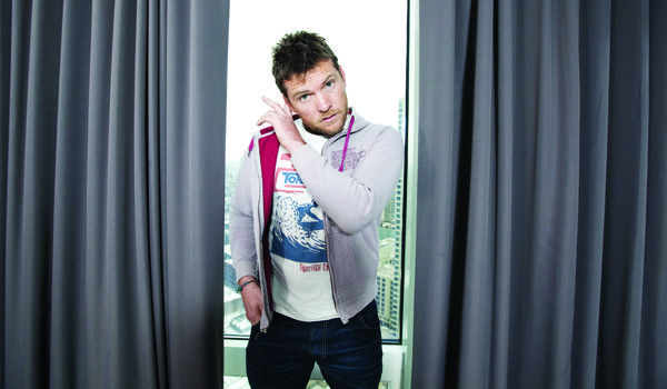 "Sam Worthington poses at the Trump Tower in Chicago during interviews for ""Man on a Ledge."""