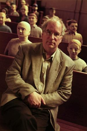 "Brewster Kahle is seen sitting with some of the ""clay librarians"" at the Internet Archive in San Francisco."