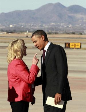 Arizona Gov. Jan Brewer points at President Obama after his arrival at Phoenix-Mesa Gateway Airport.