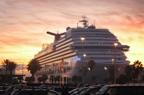 The cruise ship The Carnival Dream arrives before dawn at Port Canaveral, Fla.