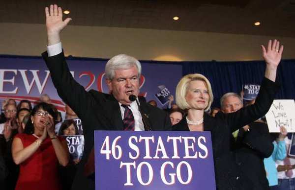 Newt Gingrich, with wife Callista, addresses his supporters after finishing a distant second to challenger Mitt Romney in the Florida Republican Primary.