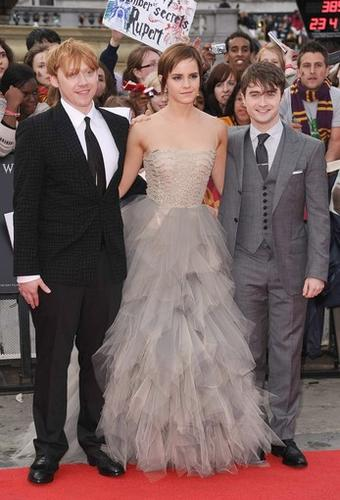 """Fans from around the world gathered in London's Trafalgar Square to celebrate the eighth and final film in the """"Harry Potter"""" franchise and catch a glimpse of their favorite stars, including Rupert Grint, left, Emma Watson and Daniel Radcliffe. """"Harry Potter and the Deathly Hallows - Part 2"""" brings Harry's lifelong feud with the evil Lord Voldemort to Hogwarts for one final, deadly battle."""