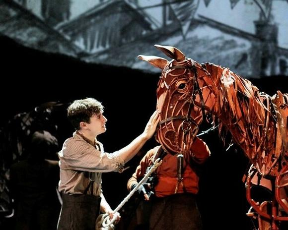 Seth Numrich and the puppet for Joey, created  by the Handspring Puppet Compa
