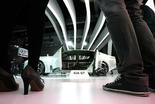 Young visitors look at the Kia GT at the L.A. Auto Show.