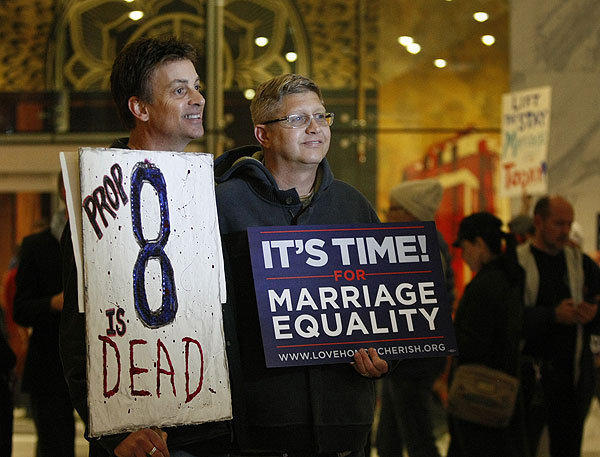 Steve Ledoux, left, and his spouse, Mark Becktold, who were married before Proposition 8 was passed, join members of Love Honor Cherish and West Hollywood officials at a celebration of the appellate panel's rejection of the state's ban on same-sex marriage.