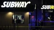 Chicago police investigate a shooting at a Subway