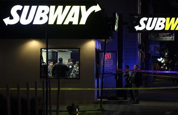 Chicago police investigate a shooting at a Subway restaurant on the 1100 block of North Western Avenue in Chicago on Thursday.