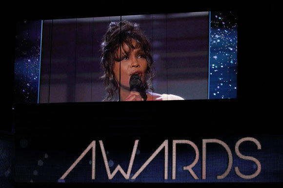 Singer Whitney Houston is shown on a video screen during the 54th annual Grammy Awards on Sunday, Feb. 12, 2012.