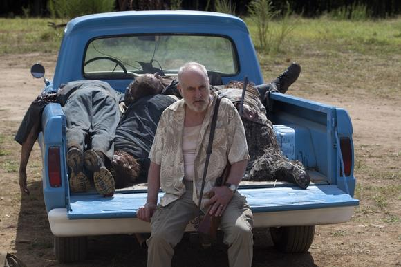 Dale (Jeffrey DeMunn) has zombie corpses for sale.