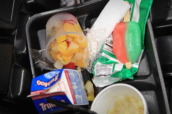 A fruit cup is tossed in the trash at Eustis Elementary, which requires students to pick a fruit or vegetable cup during lunchtime to help comply with new federal legislation.