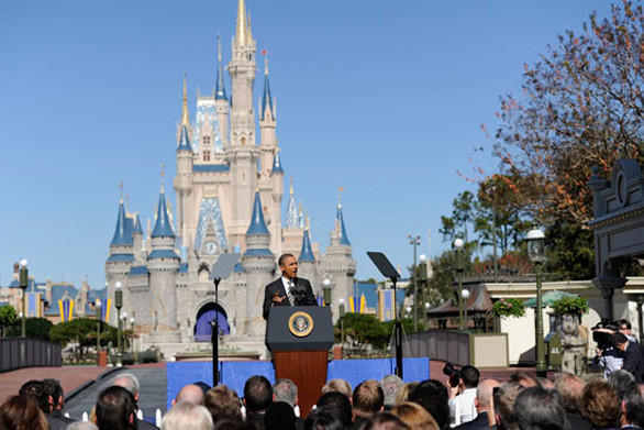 President Obama speaks about tourism in front of Cinderella Castle at the Magic Kingdom in Orlando.
