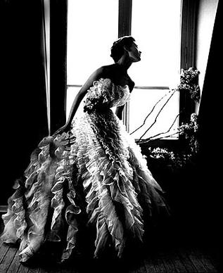"Lillian Bassman shot this photograph, called ""Fantasy on the Dance Floor,"" featuring model Barbara Mullen in a Christian Dior dress, for Harper's Bazaar in 1"