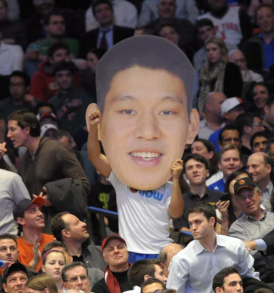 "A fan holds up a large image of <a class=""taxInlineTagLink"" id=""ORSPT000200"" title=""New York Knicks"" href=""/topic/sports/basketball/new-york-knicks-ORSPT000200.topic"">New York Knicks</a> guard <a class=""taxInlineTagLink"" id=""PESPT0000010819"" title=""Jeremy Lin"" href=""/topic/sports/basketball/jeremy-lin-PESPT0000010819.topic"">Jeremy Lin</a> during a game against the <a class=""taxInlineTagLink"" id=""ORSPT000115"" title=""Sacramento Kings"" href=""/topic/sports/basketball/sacramento-kings-ORSPT000115.topic"">Sacramento Kings</a>."