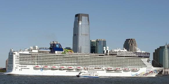 A New York Waterway ferry is dwarfed by the cruise ship Norwegian Epic as she sails up the Hudson River on July 1, 2010 in New York. The Norwegian Cruise Line ship, on her Maiden Voyage from Southampton to New York, is claimed to be the largest ship to ever dock in a New York Passenger Ship Terminal.