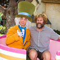 """Megamind"" star Will Ferrell looks downright grumpy sitting in a tea cup with the Mad Hatter at Disneyland."