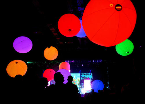 Giant colorful balls float onto the audience in the finale of the Blue Man Group's show-in-residence at Universal Orlando, during a media preview of the 2012 version of the interactive stage show, Thursday, February 16, 2012.