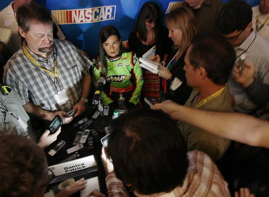 Danica Patrick is interviewed during NASCAR Media Day at Daytona International Speedway.