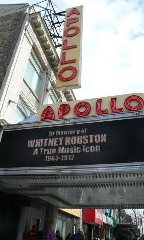 The marquee of Harlem's Apollo Theater bears a tribute to superstar Whitney Houston Sunday, Feb. 12, 2012, in New York.