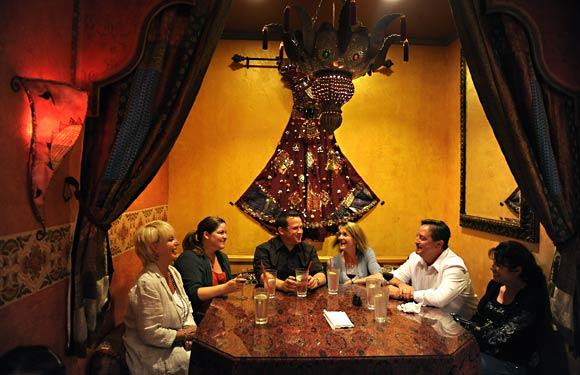 Friends enjoy each others' company at Open Sesame restaurant along 2nd Street in the Belmont Shore area of Long Beach.