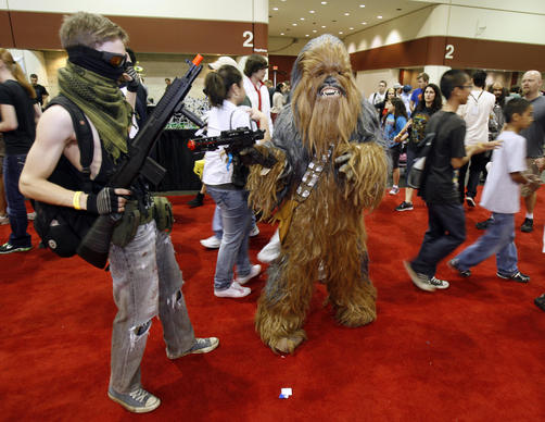 LeJuan Chastang, 17, left, gets his photo taken with Chewbacca from the Star Wars series, played by Jamie Perez, both of Orlando, during MegaCon at Orlando Convention Center in Orlando, Fla. Saturday, February 18, 2012.
