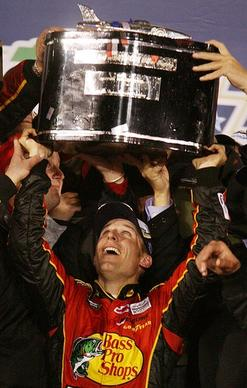 Jamie McMurray hoists the Daytona 500 trophy in Victory Lane after winning the Daytona 500 at Daytona International Speedway on Sunday, February 14, 2010