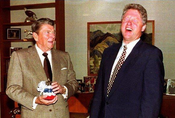 Former President Ronald Reagan presents then-President-elect Clinton with a jar of red, white and blue jelly beans in November 1992.