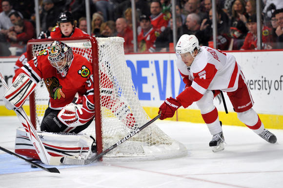 Corey Crawford makes a save against Detroit Tuesday night. (Rob Grabowski/US Presswire)