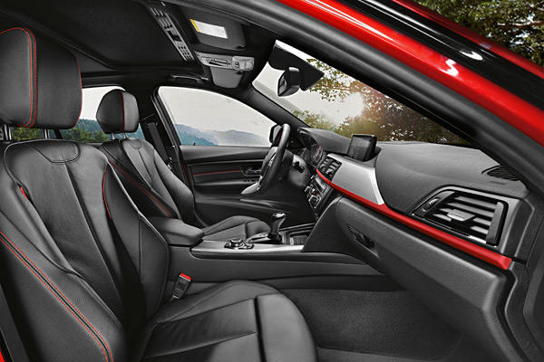 Sport trim gives you a sport-tuned suspension that's also slightly lower, sport seats and various sport-oriented interior and exterior trim. As on the 328i, the Sport line adds $1,700 to the base price of the 335i.