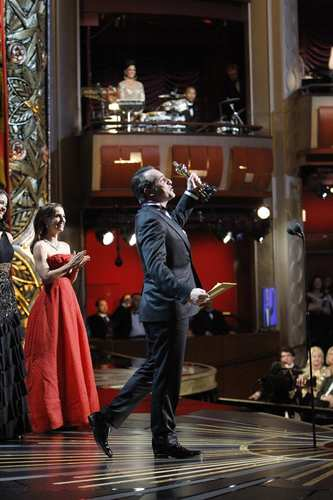 """The Artist"" actor celebrates his lead actor win from the Oscar stage."