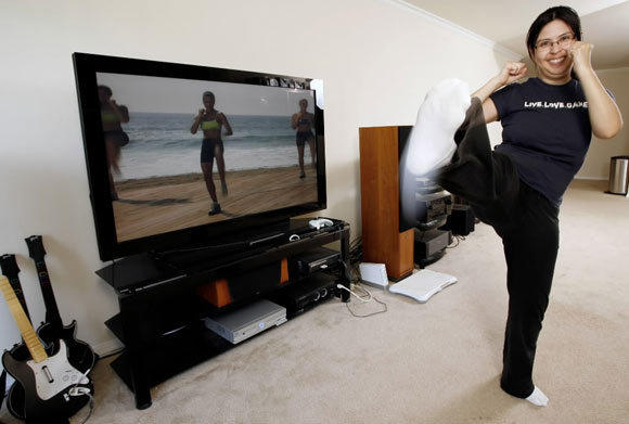 Woman does daily aerobics in her apartment