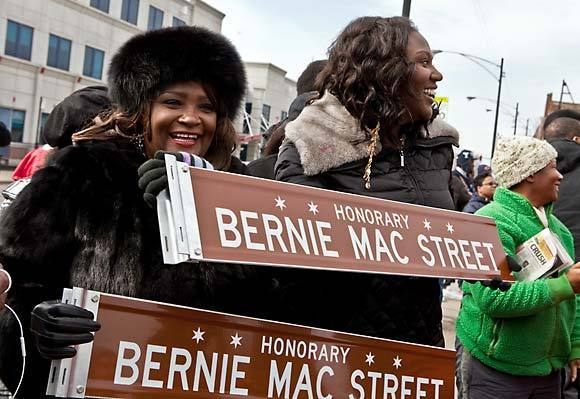 Rhonda McCullough, wife of Bernie Mac, and their daughter Je'Niece McCullough hold a new street sign during a dedication ceremony today for ¿Bernie Mac Street.¿