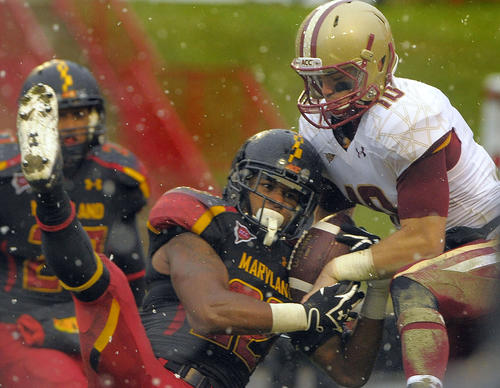 Maryland cornerback Cameron Chism, left, intercepts a pass intended for Boston College's Bobby Swigert at the 2-yard line to end the second quarter.