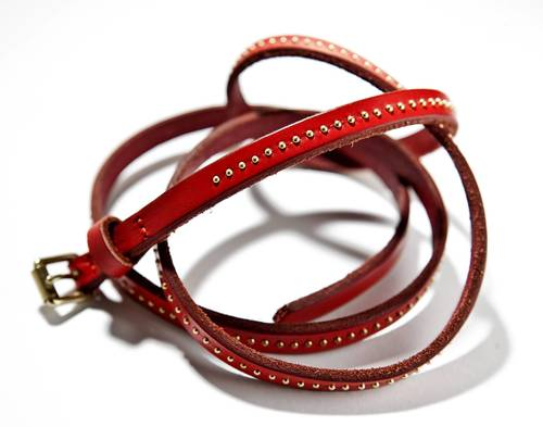 "This red studded belt from J. Crew is $35; <a href=""http://jcrew.com"">jcrew.com</a>."
