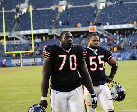 Edwin Williams and Lance Briggs leave the field after the Bears lost 38-14 to the Seahawks.