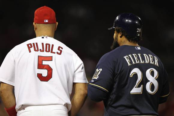 Albert Pujols of the St. Louis Cardinals and Prince Fielder of the Milwaukee Brewers stand at first base during Game 4 of the National League Championship Series.
