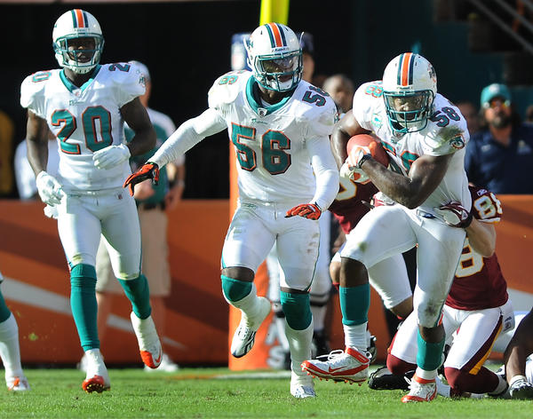 Miami's Karlos Dansby returns a key fourth quarter interception.