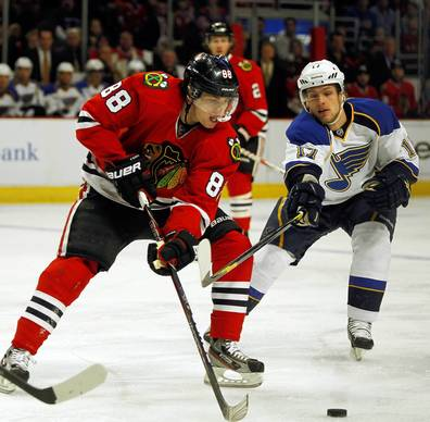 Chicago Blackhawks right wing Patrick Kane (88) and St. Louis Blues center Vladimir Sobotka (17) go for the puck in the first period at the United Center on Sunday.