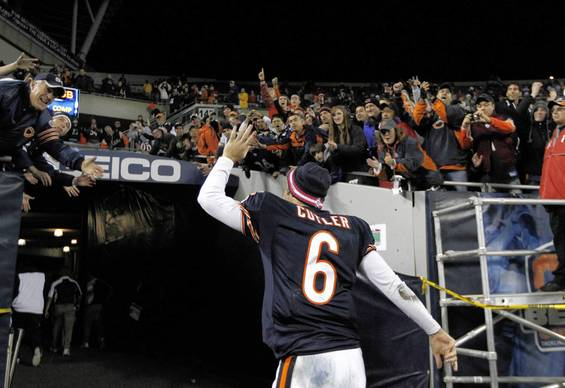Jay Cutler throws a towel in the stand as he walks off the field following his team's 39-10 win.