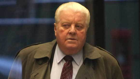 Former Chicago police commander Jon Burge arrives for sentencing on Jan. 20, 2011.