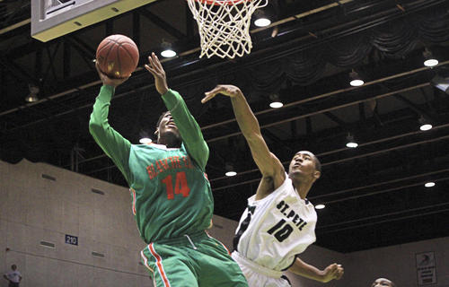 Blanche Ely's Clide Geffrard goes up to the basket during third quarter action of a Class 7A state boys basketball semifinal against St. Petersburg.