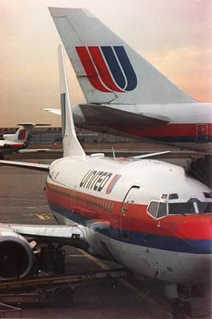 A United Airlines Boeing 737 unloads passengers at O'Hare International  Airport on March 25, 1994.