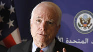 "<span style=""font-size: small;""><a class=""runtimeTopic"" href=""#"">John McCain</a> must have a stack of forms on his desk demanding U.S. military intervention abroad, with a blank space to fill in the name of the country he wants to attack. </span>"