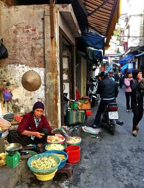 A vendor sells tofu along a narrow street leading to Dong Xuan Market in Hanoi, which is emerging as a foodie mecca. Soup is a way of life here, but finding the perfect bowl is a quest that will lead you throughout the city. Along the way, you'll find religion, history, art and the theater of everyday life.