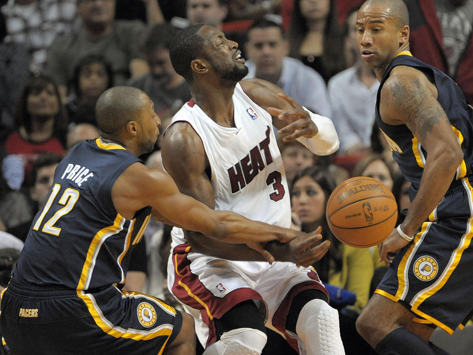 Miami Heat guard Dwyane Wade is fouled by Indian Pacers guard A.J. Price during the first half of their game.