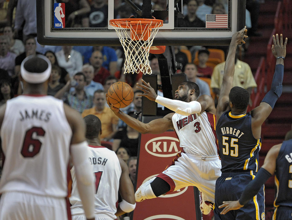 Miami Heat guard Dwyane Wade takes a shot in front of Indian Pacers center Roy Hibbert during the first half of their game.