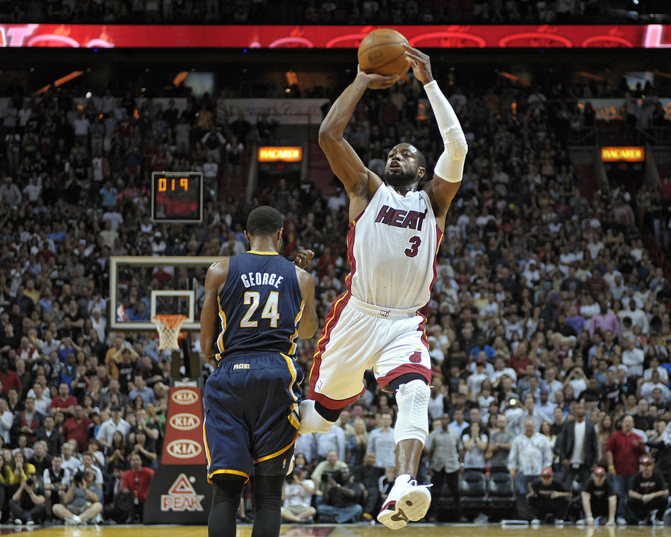 Miami Heat guard Dwyane Wade shoots the game winning shot over Indian Pacers guard Paul George during overtime of their game.