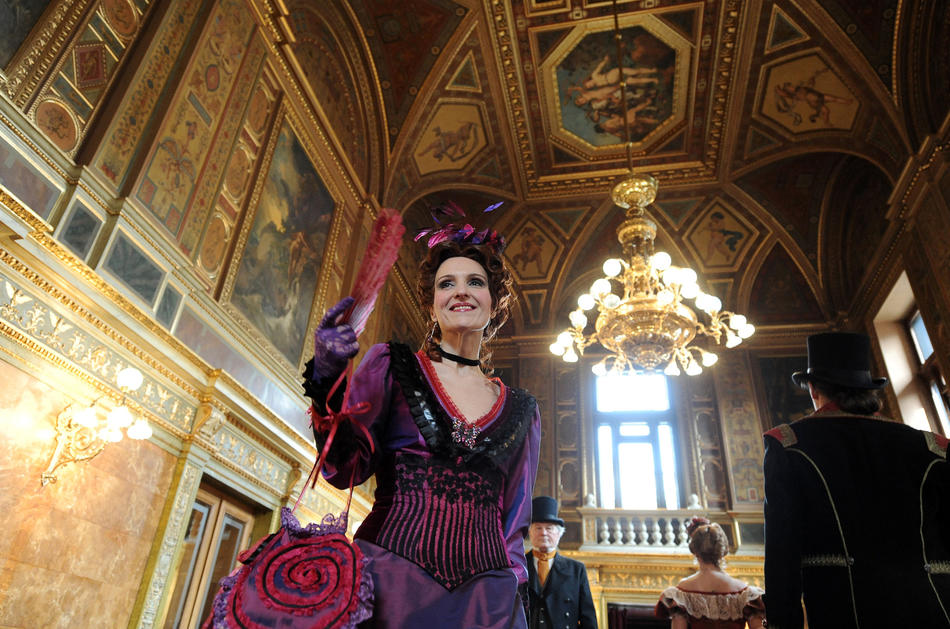 Cast members present their costumes created by Hungarian costume designer Rita Velich for 'Arabella' an opera by late Austrian composer Richard Strauss', in the Karoly Lotz Hall of the Hungarian State Opera.