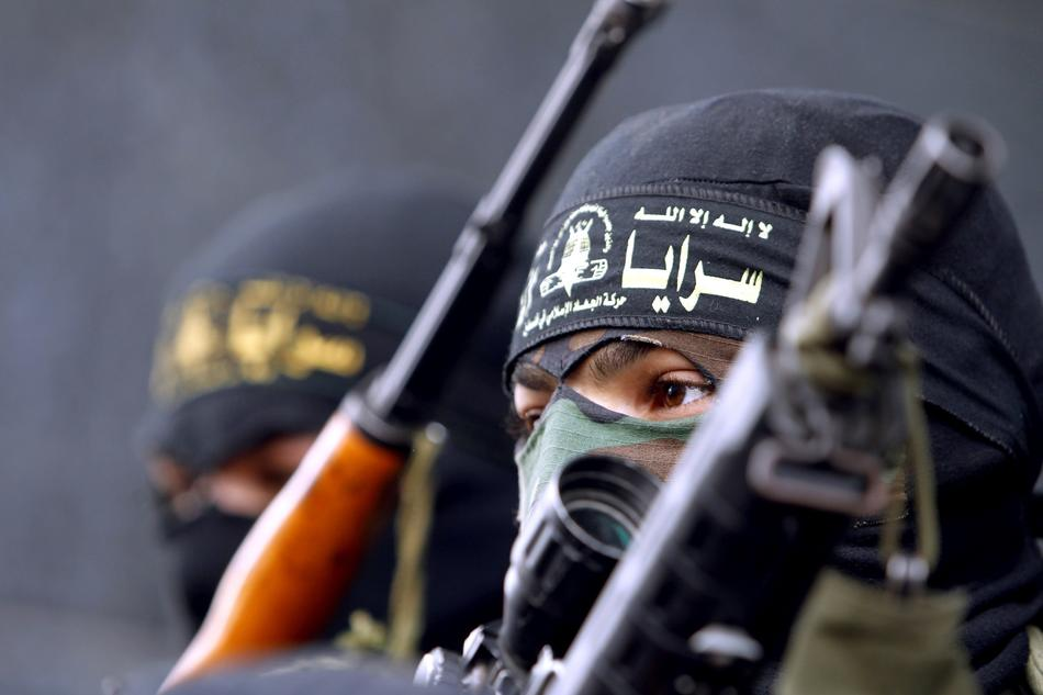An Islamic Jihad militant speaks during a press conference in Gaza City on March 12, 2012, following overnight Israel air strikes on the Gaza Strip in which two Palestinians were killed.