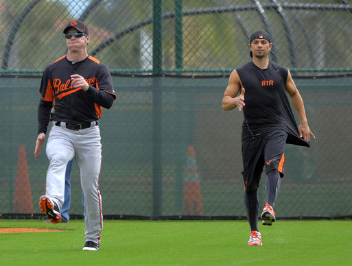 Baltimore Orioles special assistant Brady Anderson (left) works with infielder Brian Roberts during spring training at the Sarasota Sports Complex.